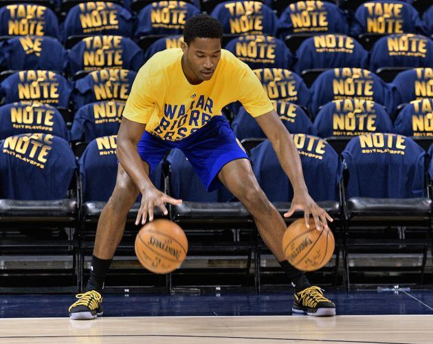 Damian Jones warms up before the game.