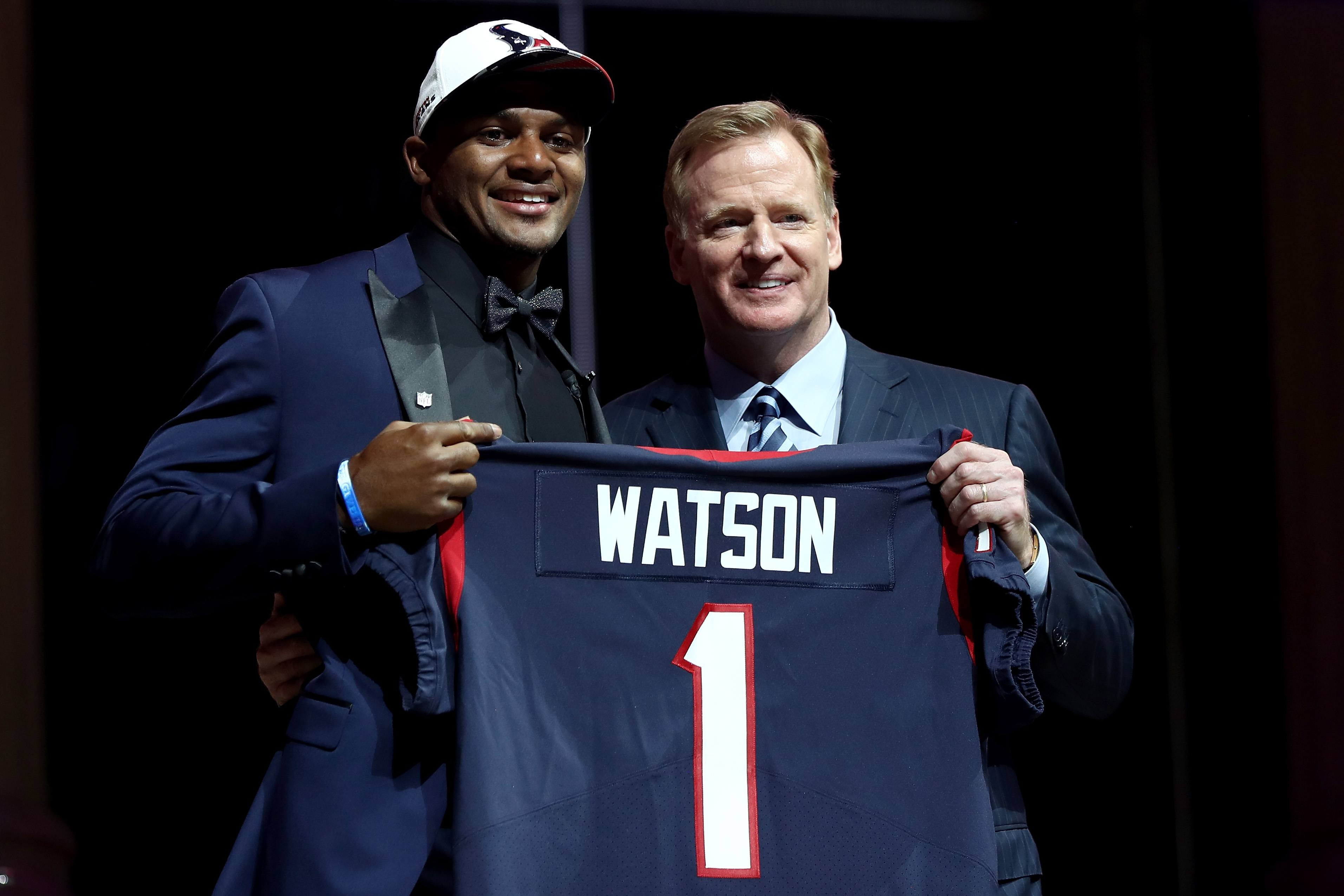 Deshaun Watson poses with NFL Commissioner Roger Goodell after being drafted by the Houston Texans.