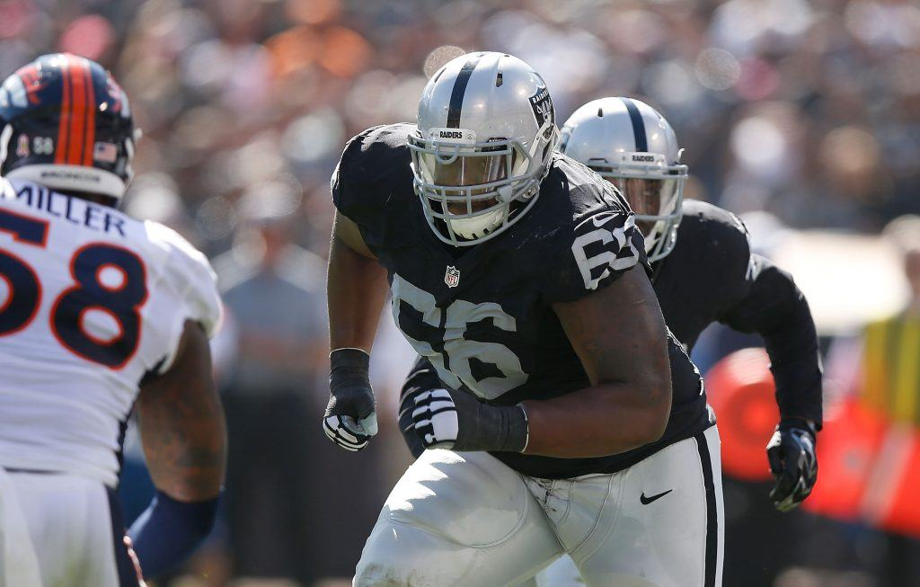 Gabe Jackson blocks for Latavius Murray in 2015.