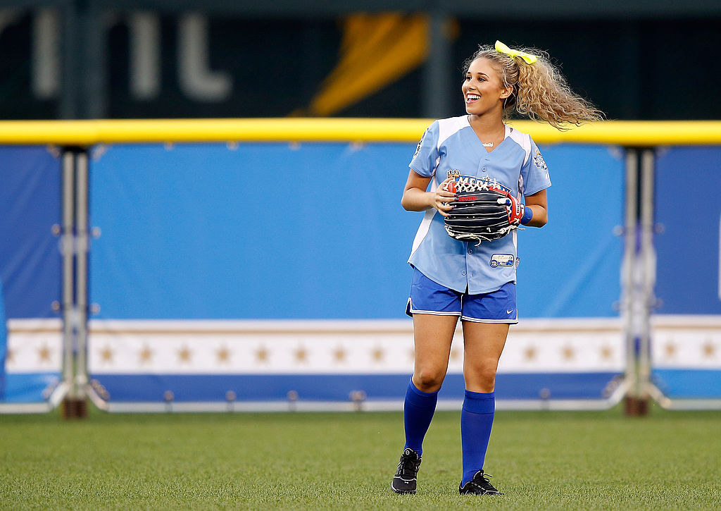 Singer Haley Reinhart stands in front of the artificial fence during the Taco Bell All-Star Legends & Celebrity Softball Game.