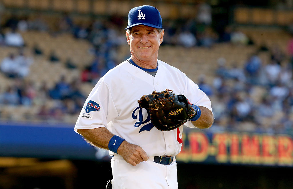 Steve Garvey smiles on the mound.