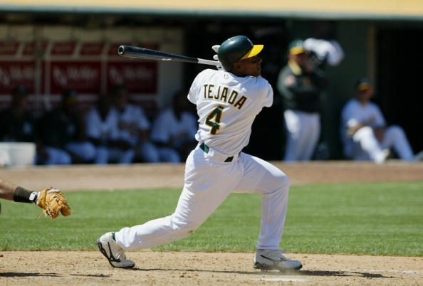 Miguel Tejada follows through on his hit.