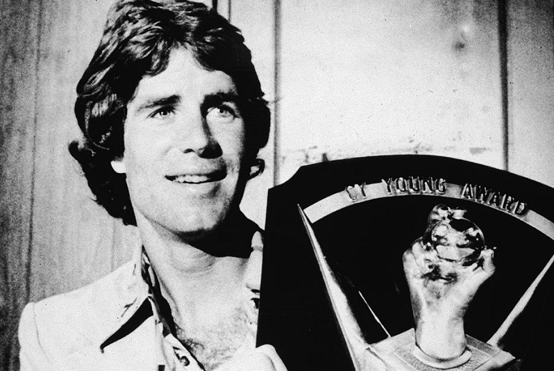 American baseball player Jim Palmer holds up his Cy Young award, one of three he won over the course of his career, 1975.
