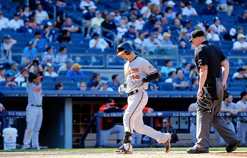 Caleb Joseph of the Baltimore Orioles touches home plate after his home run at Yankee Stadium.