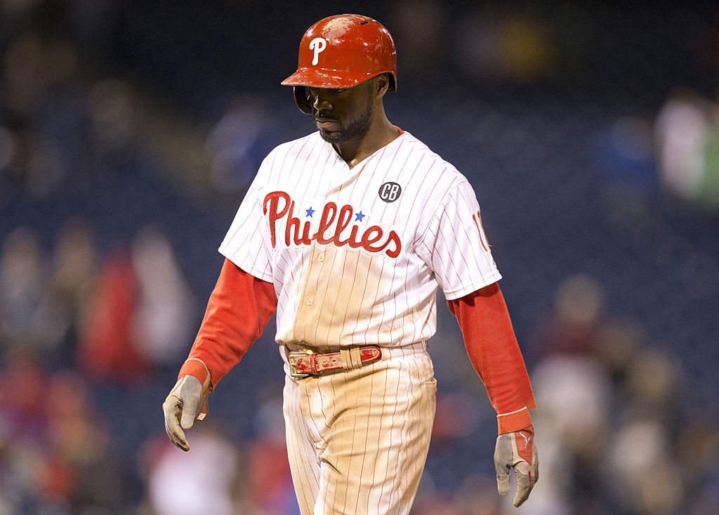 Shortstop Jimmy Rollins of the Philadelphia Phillies walks off the field.