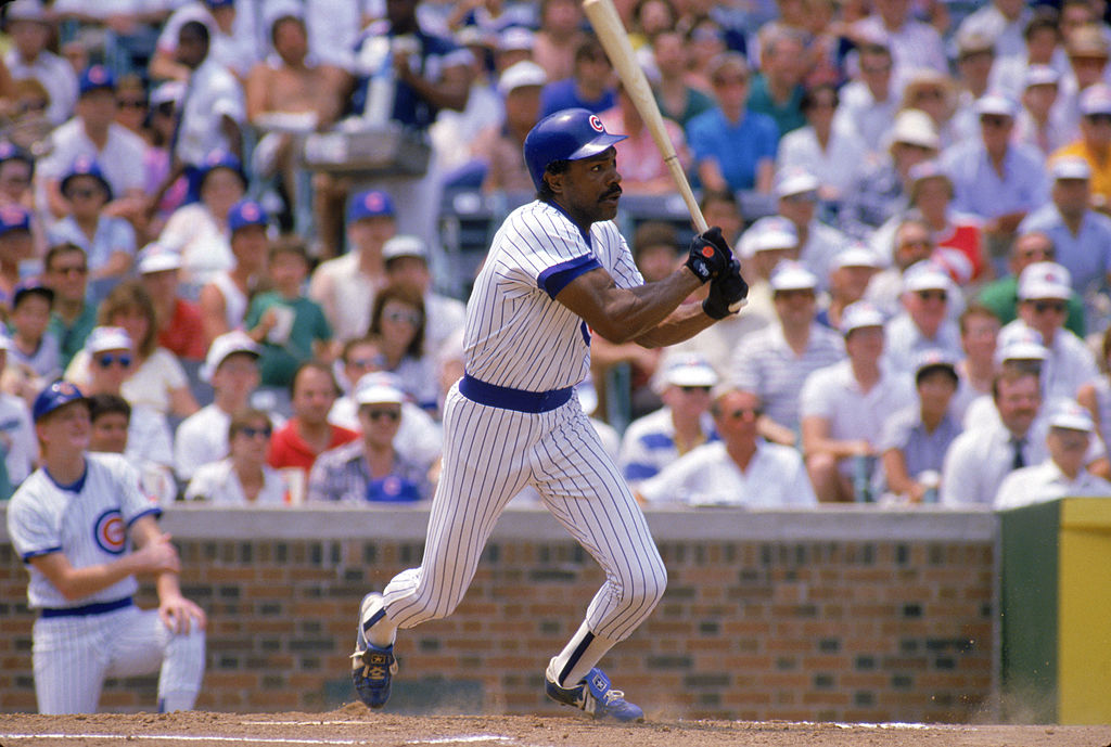 Andre Dawson of the Chicago Cubs watches the flight of the ball as he follows through.