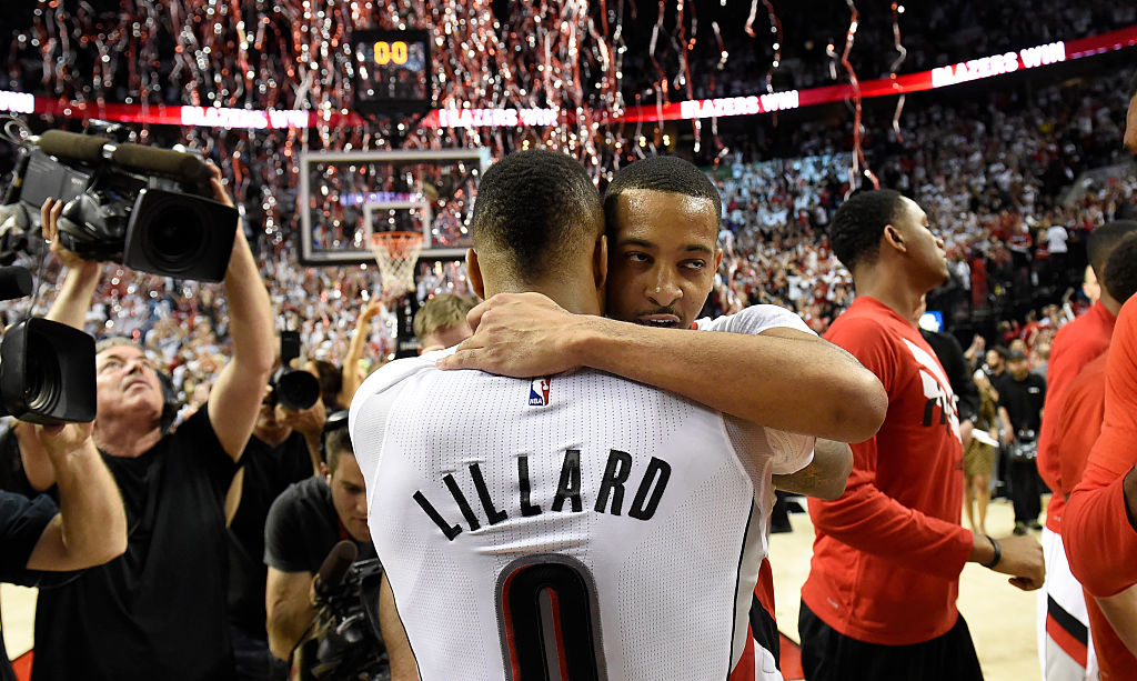Damian Lillard and C.J. McCollum embrace after their Game 6 victory over the Los Angeles Clippers.