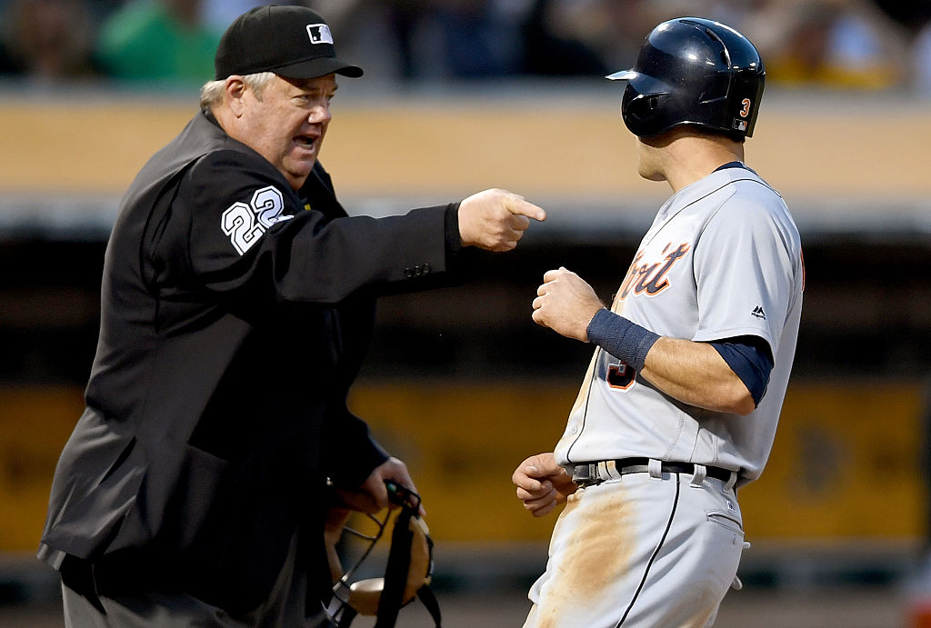 Umpire Joe West yells at a Detroit Tigers player.