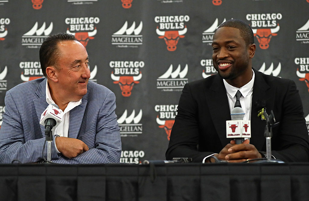 General Manager Gar Forman of the Chicago Bulls presents new Bull Dwyane Wade during an introductory press conference.