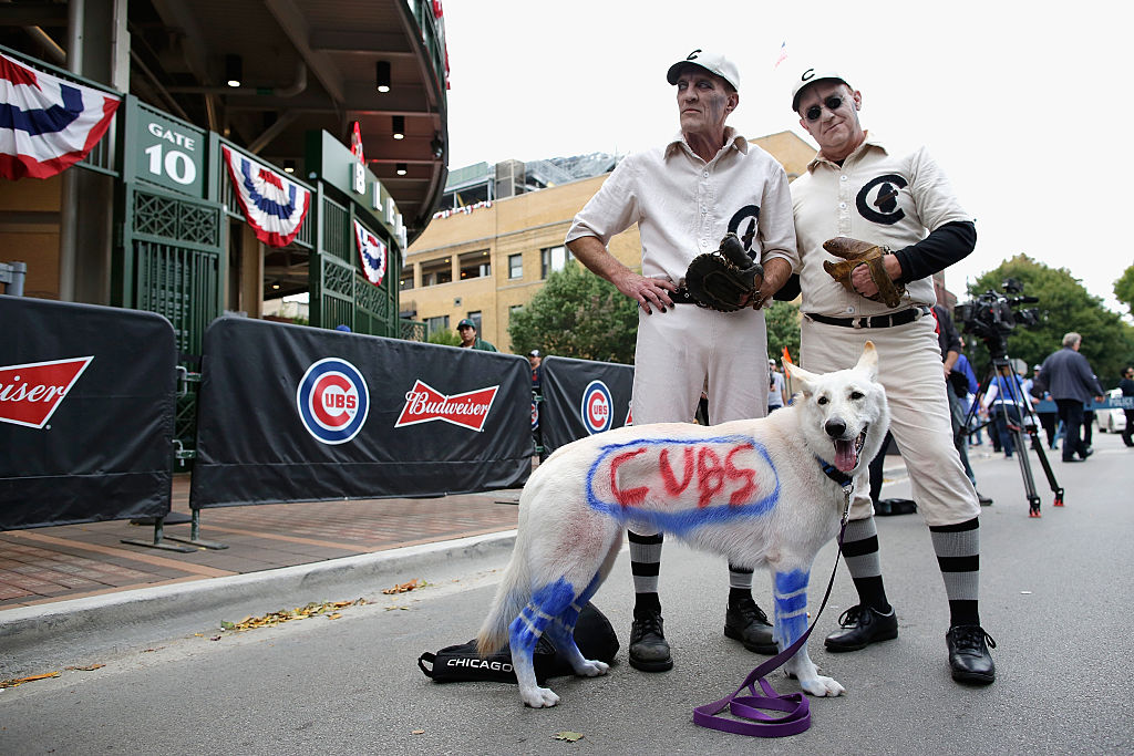 Some Cubs fans stand near Wrigley Field.