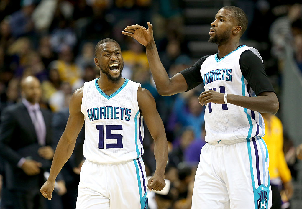 Kemba Walker and Michael Kidd-Gilchrist celebrate a big basket.