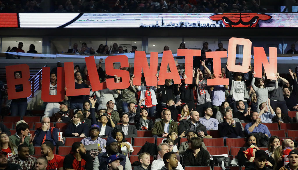 "Chicago fans hold up a ""Bulls Nation"" sign."
