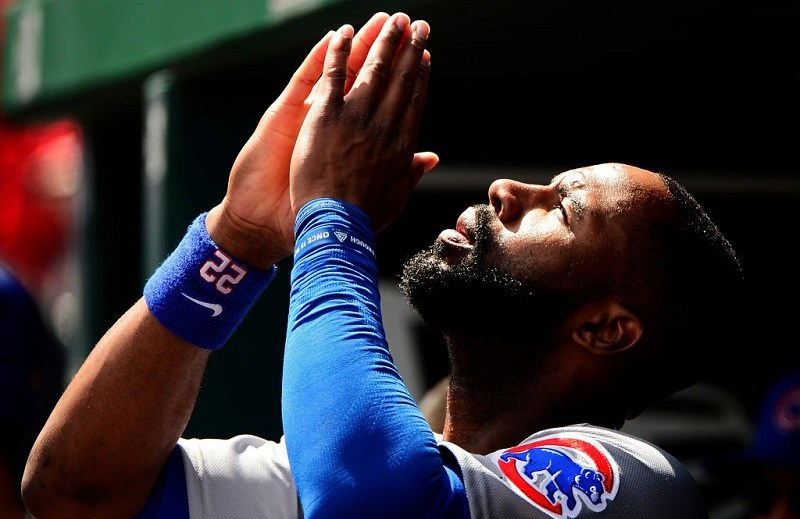 Cubs outfielder Jason Heyward offers a prayer.