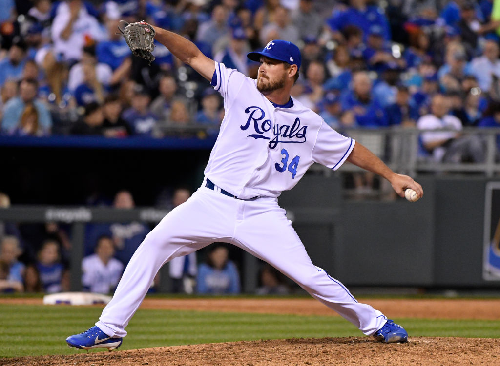 Travis Wood pitches.