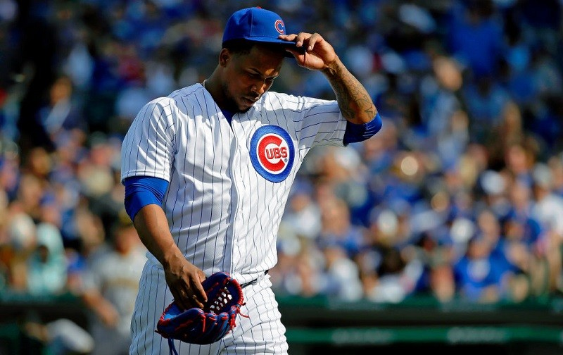 Pedro Strop of the Chicago Cubs reacts as he walks off the field.