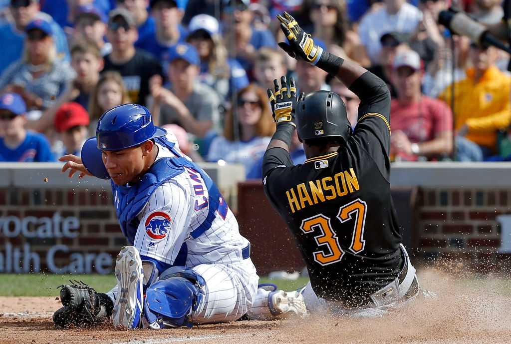 Alen Hanson slides home safely for the Pittsburgh Pirates.
