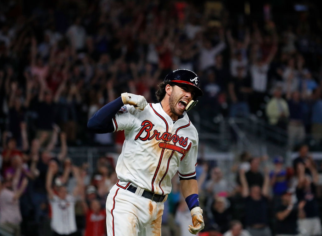 Dansby Swanson of the Atlanta Braves reacts after hitting a walk-off single.