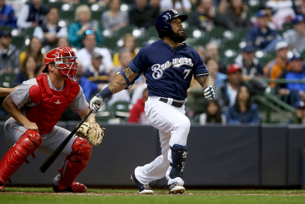 Eric Thames watches his hit as he prepares to run to first.