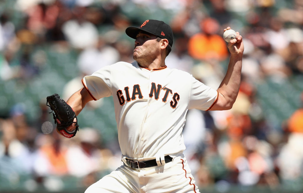 Matt Moore pitches for the Giants.