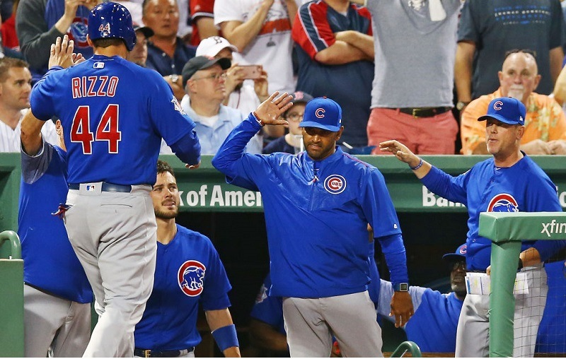 Anthony Rizzo is high-fived as he enters the Chicago Cubs dugout.