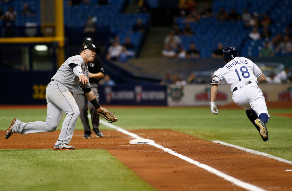 Peter Bourjos gallops down to first base.