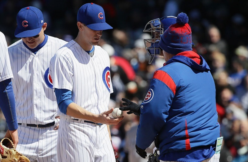 Starting pitcher Kyle Hendricks of the Chicago Cubs is taken out of the game by manager Joe Maddon.