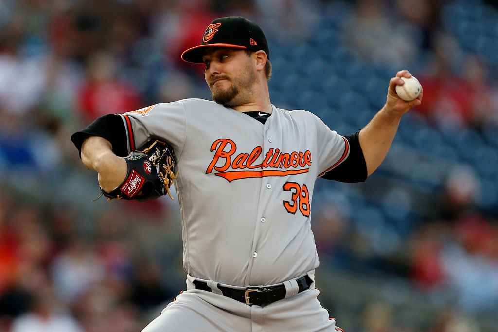 Wade Miley hurls for Baltimore.