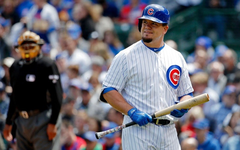Kyle Schwarber walks away after striking out.