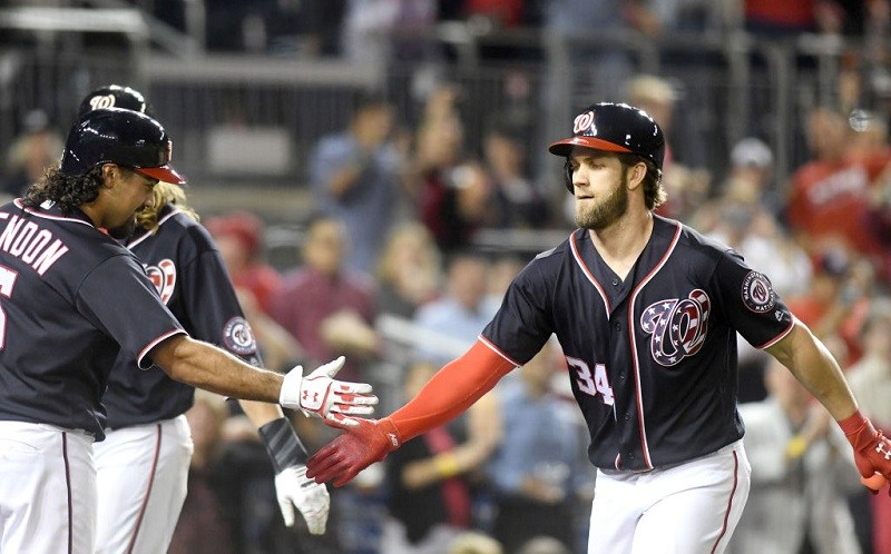 Bryce Harper of the Washington Nationals celebrates hitting a two-run home run with Anthony Rendon.