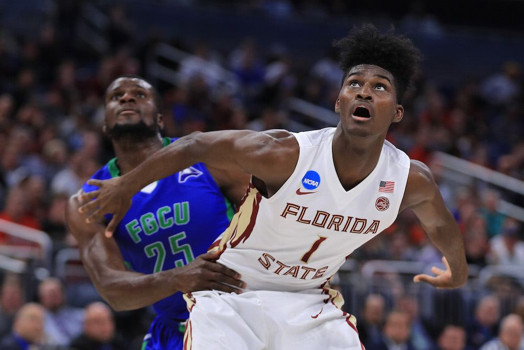 FSU's Jonathan Isaac fights for position.
