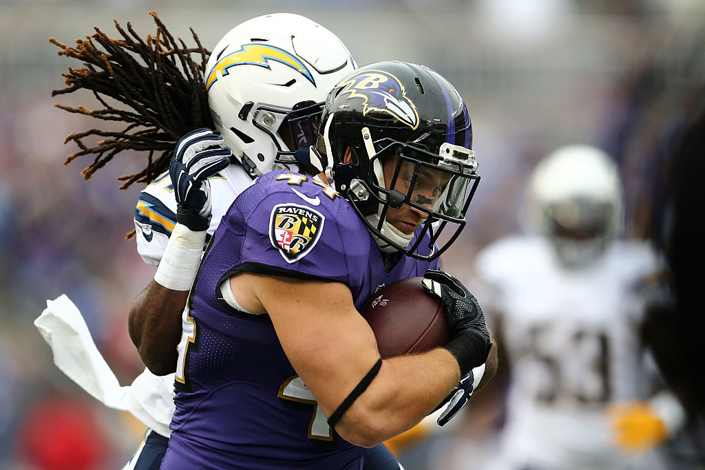 Fullback Kyle Juszczyk, now with the San Francisco 49ers, is tackled by strong safety Jahleel Addae of the San Diego Chargers.