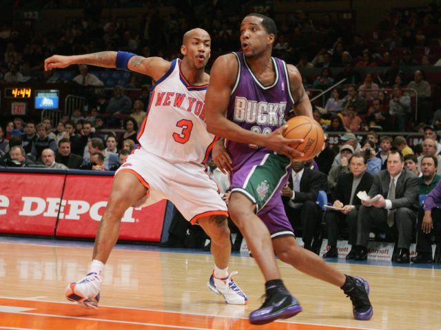 Michael Redd drives baseline.