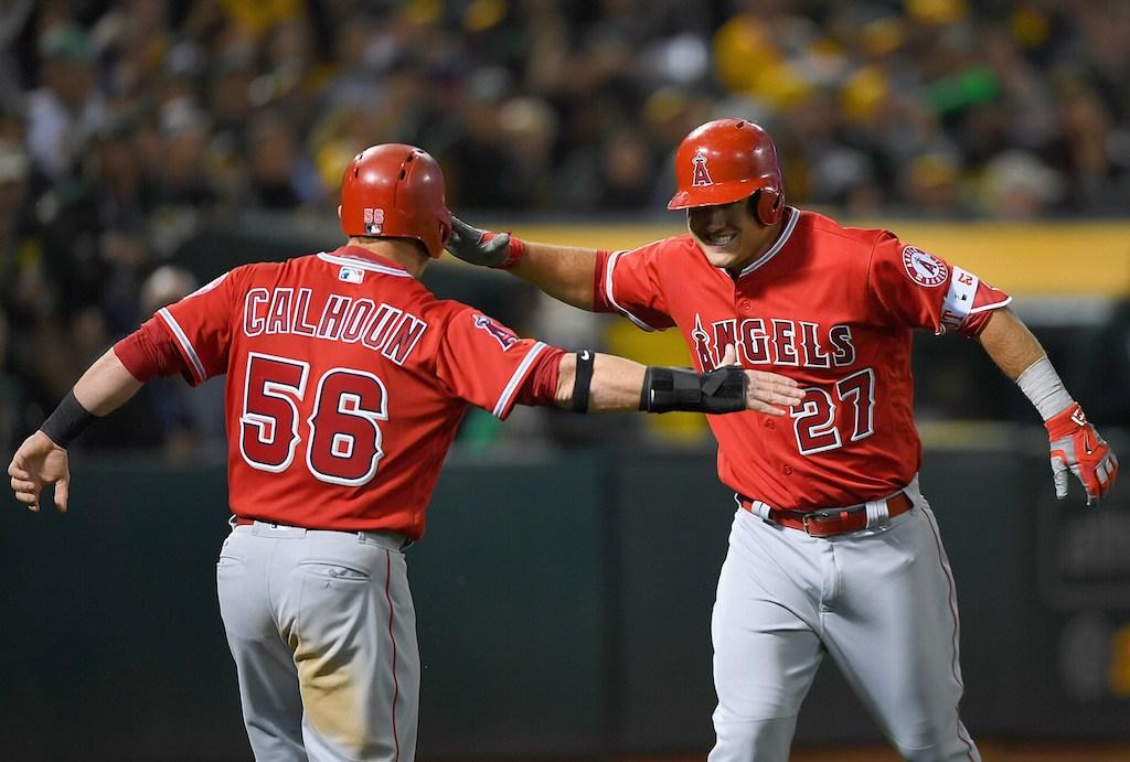 Kole Calhoun and Mike Trout celebrate a home run.