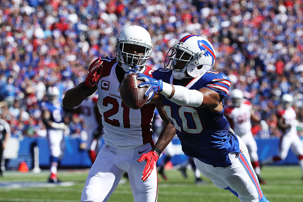 Robert Woods, now with the Los Angeles Rams, makes a catch past Patrick Peterson of the Arizona Cardinals.