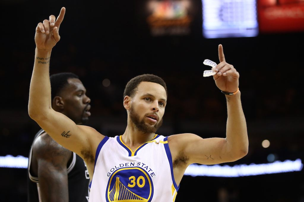 Stephen Curry signals after a play.