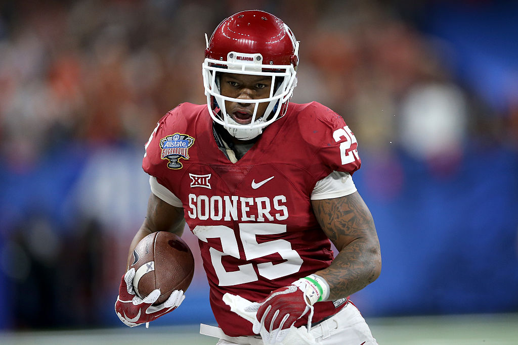 Joe Mixon of the Oklahoma Sooners runs with the ball.