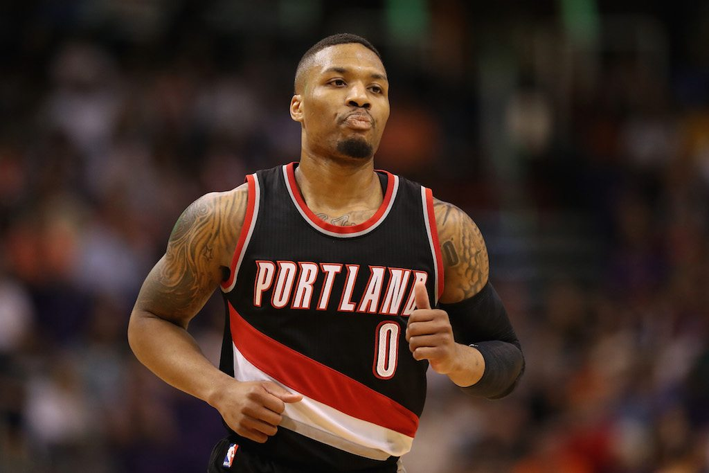 Damian Lillard runs backward during a game.