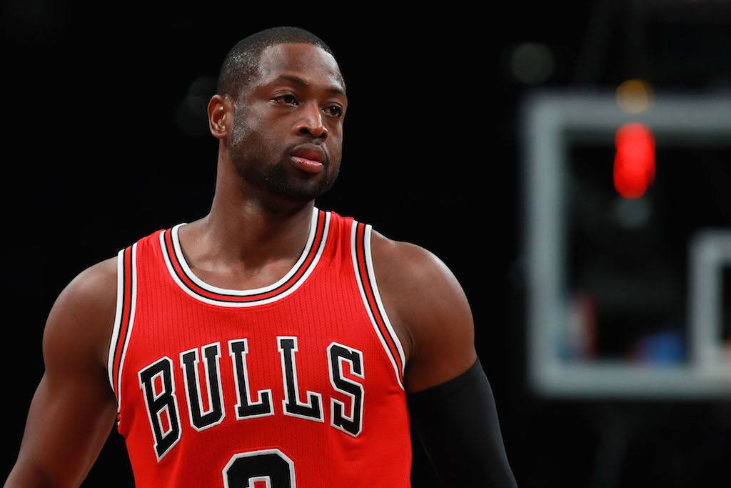 Dwyane Wade looks on during a game.