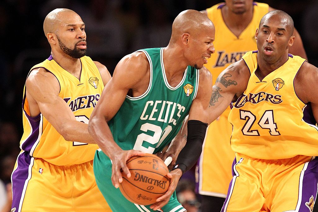 The Lakers surround the Celtics in an effort to get the ball.