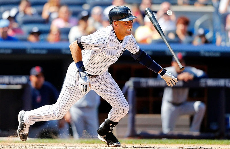 Derek Jeter of the New York Yankees follows through on an infield base hit.
