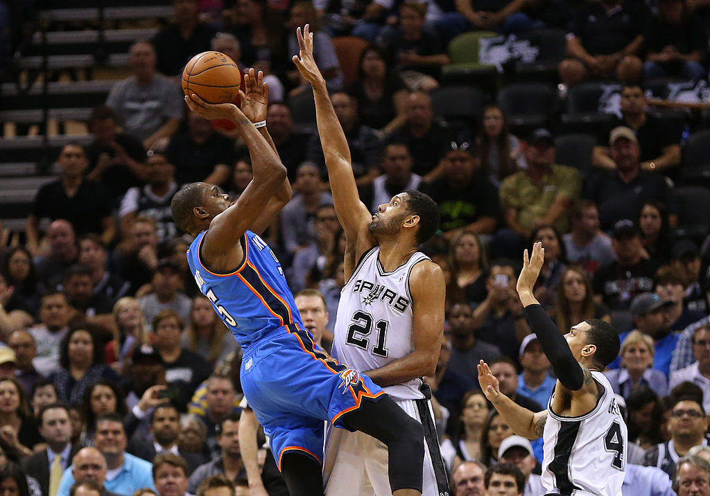 One of the best shot blockers ever, Spurs forward Tim Duncan goes up to block Kevin Durant's shot.