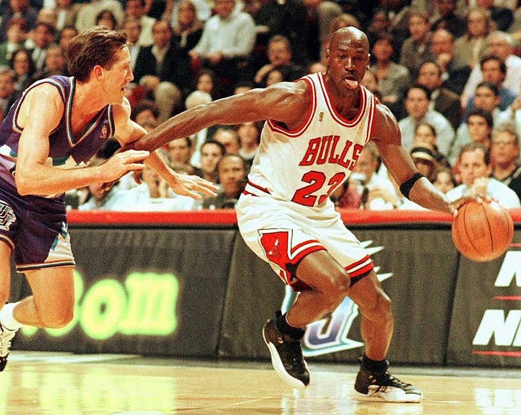 Michael Jordan drives past Jeff Hornacek in the 1997 NBA Finals.