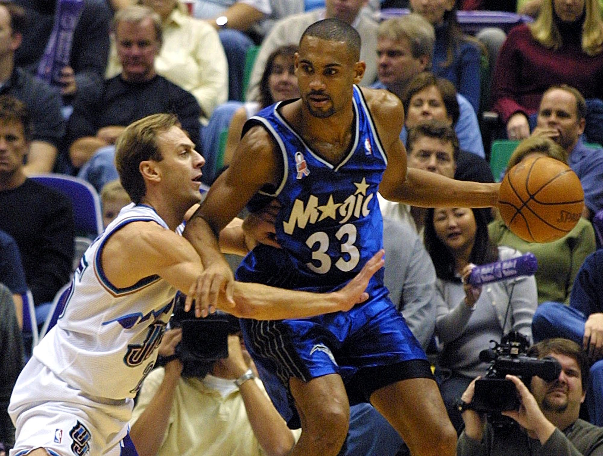 Grant Hill tries to get away from a defender.