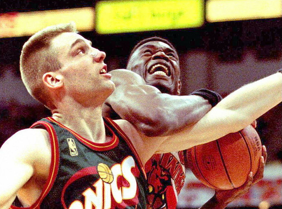 Sonics center Jim McIlvaine fights Dikembe Mutombo for a rebound.