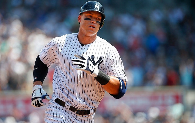 Aaron Judge of the New York Yankees rounds the bases after he hit a home run in his first MLB at bat.