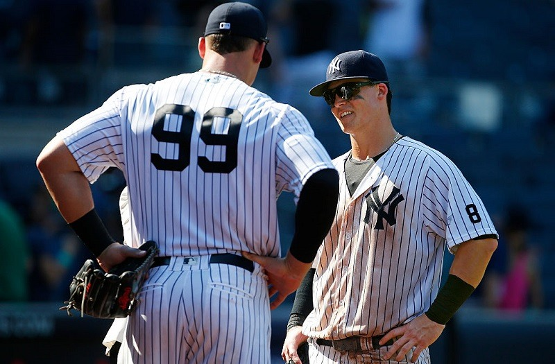Shot of Aaron Judge (with his back to camera) speaking with Yankee rookie Tyler Austin in 2016.