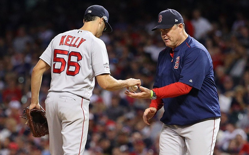 John Farrell takes the ball from Joe Kelly during Game 2 of the ALDS.