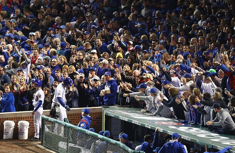 Fans cheer above the Cubs dugout during Game 6 of the 2016 National League Championship Series at Wrigley Field.