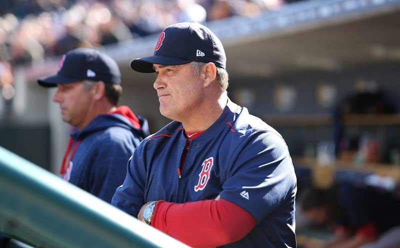 Boston Red Sox manager John Farrell watches the action.