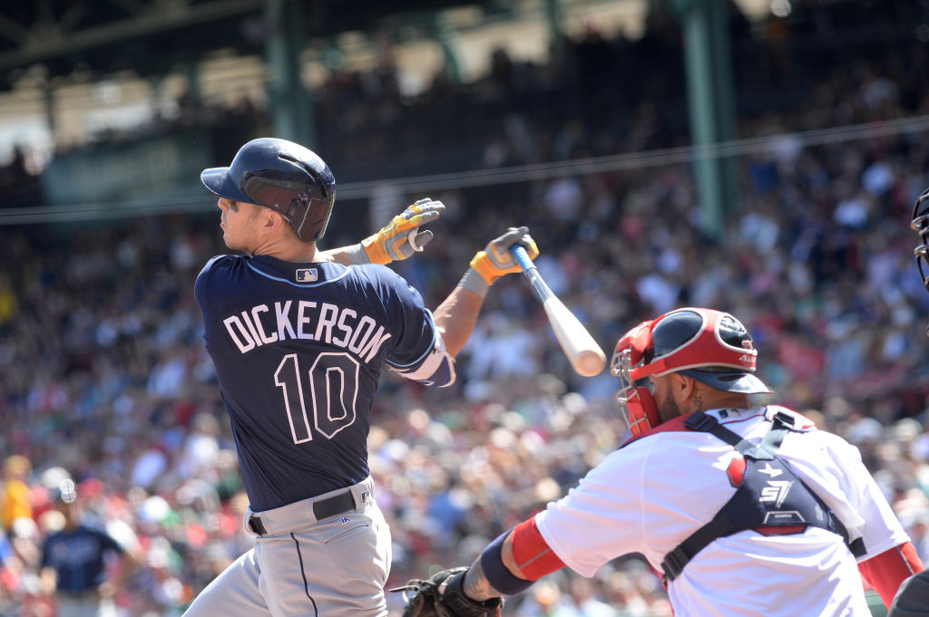 Corey Dickerson swings at a pitch in the first inning against the Boston Red Sox.